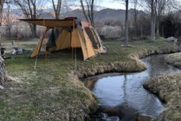 Picture of tent by stream at Millpond campground