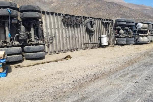 An overturned eighteen wheeler on Route 395.