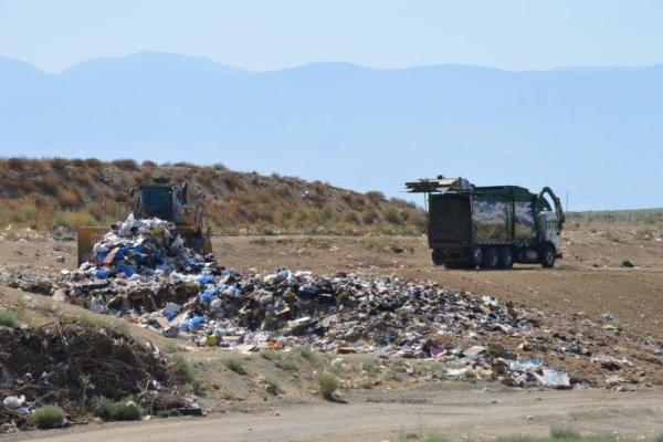 The compactor working the active face at the landfill.