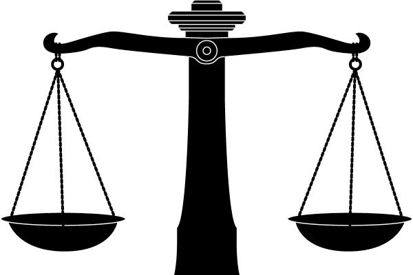 A black and white image of the scales of justice